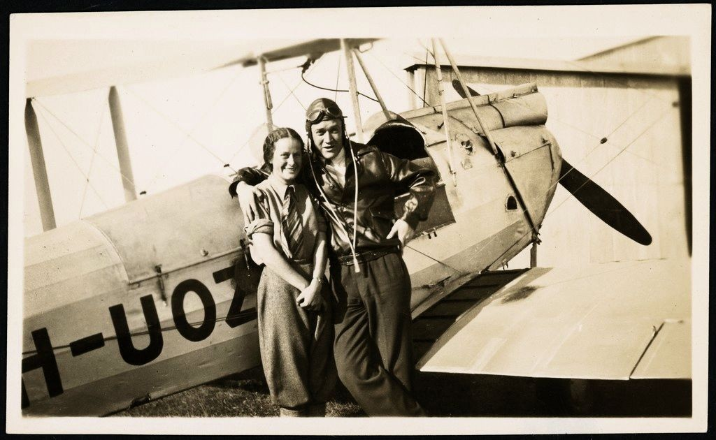 Nancy Bird and Jack Kingsford-Smith standing next to a de Havilland DH.60M Moth (VH-UOZ), Mascot [?], New South Wales, ca. 1933, 1 / E. A. Crome